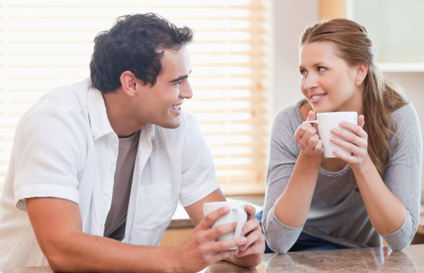 Young couple enjoying coffee in the kitchen together